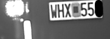 License plate with headlights